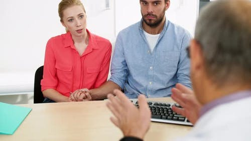 Couple Visiting Doctor at Family Planning Clinic