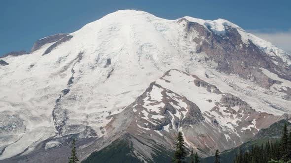 Thumbnail for Pan Up Massive Mt Rainier On Sunny Summer Day