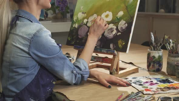 Thumbnail for Cropped Shot of a Smiling Female Artist Drawing Flowers at Her Art Studio