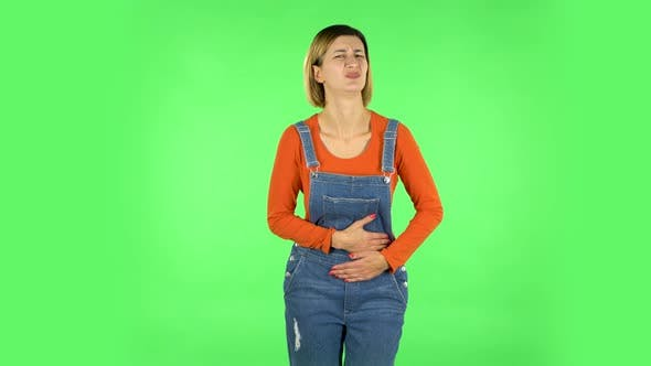 Thumbnail for Cute Female Feels Very Bad, Her Stomach Hurts . Green Screen