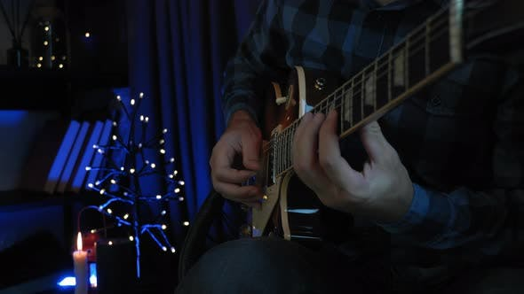 Solo guitarist is performing song on electric guitar. Music concept