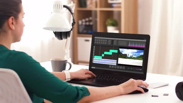 Woman with Video Editor Program on Laptop at Home