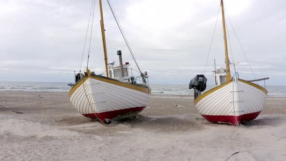 Old Fishing Boats Lined Up Ashore on Thorup Strand Beach in Denmark