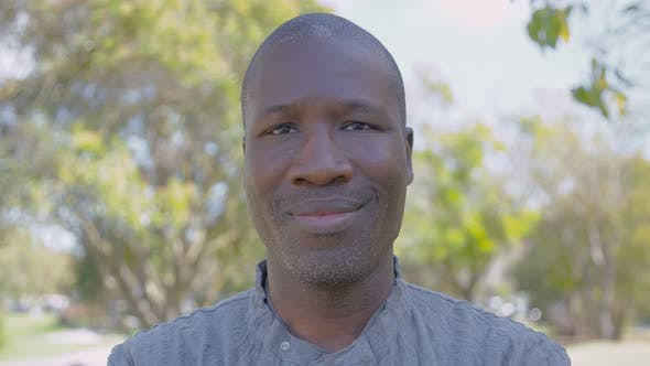 Thumbnail for Handsome Cheerful African American Man Looking at Camera.
