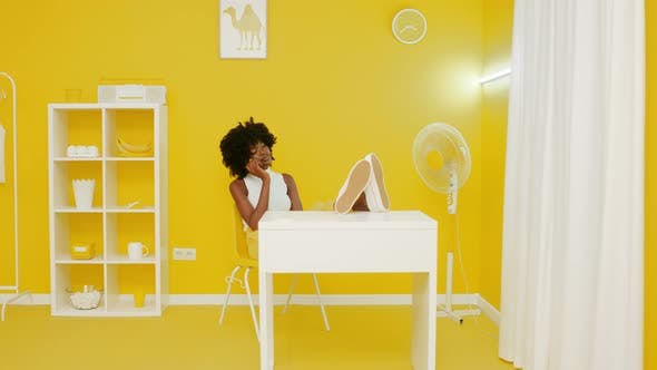 Thumbnail for African Woman Has Phone Conversation In Yellow Interior
