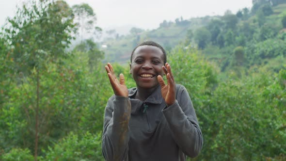 Thumbnail for Young African woman jumping and clapping hands