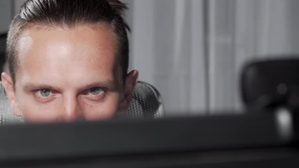 Thumbnail for Sliding Cropped Shot of a Male Eyes Looking at Computer Monitor
