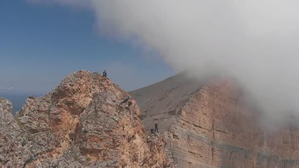 Thumbnail for Drone Shot of a Thrill-seeker Jumps Off a Cliff with a Rope