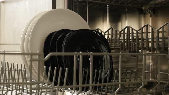 Thumbnail for Close-up of dishwashing machine rack  3840X2160  4K 2160p 30fps UltraHD footage - Table dishware  in