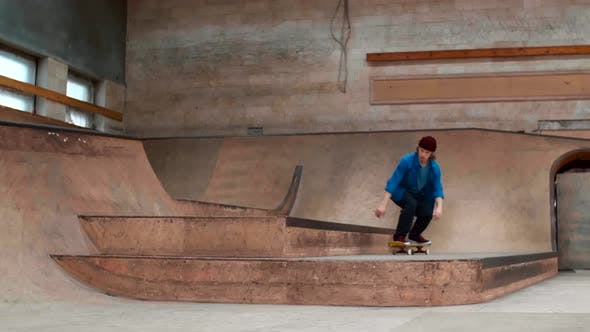 Professional Skater Practicing Jumps on Ramp
