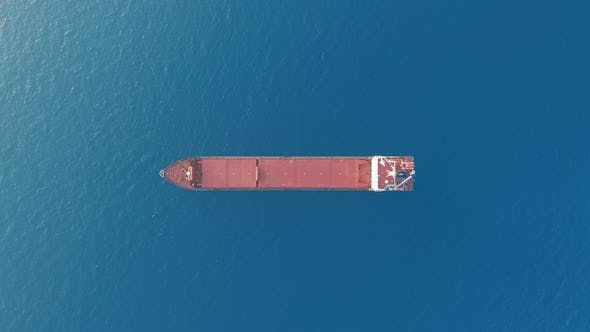 Thumbnail for Aerial View. Red Deck Cargo Ship Sailing on Open Sea.