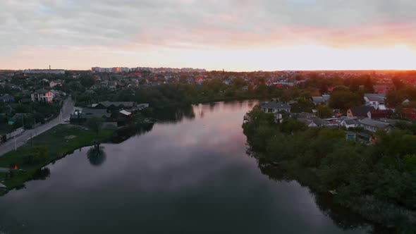 Cover Image for Drone Fly Above River in Beautiful Small European City During Sunset in Spring