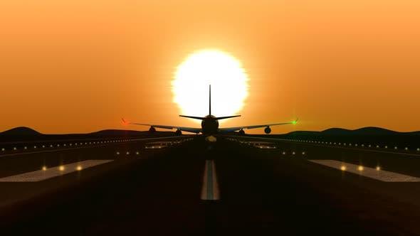 Cover Image for Airplane Landing against Orange Sunset