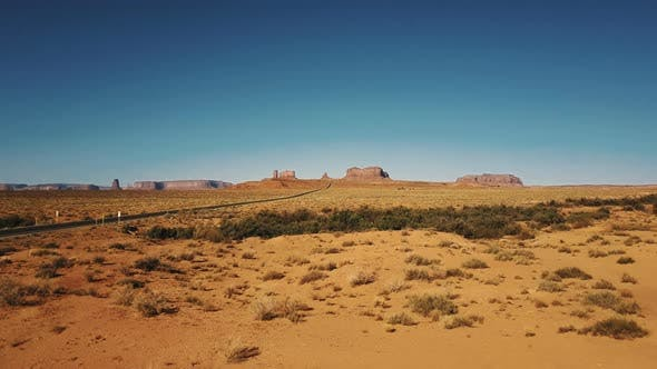 Drone Flying Low Above Dry American Sandstone Desert Near Monuments Valley in Arizona and Utah