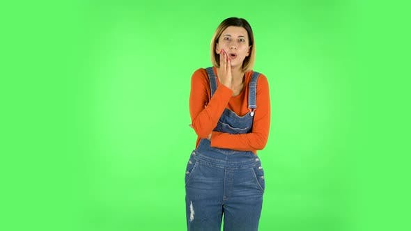 Thumbnail for Girl Listens To Information Looking at Camera, Is Shocked and Very Upset . Green Screen