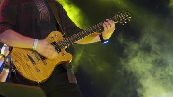 Thumbnail for Guitarist at a Rock Concert Plays Electric Guitar on the Open Stage. Slow Motion