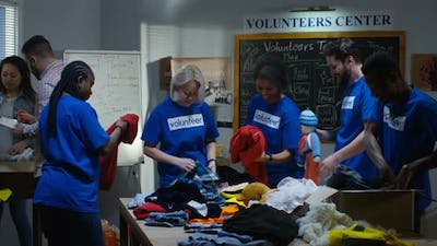 Volunteer Team Packing Clothes
