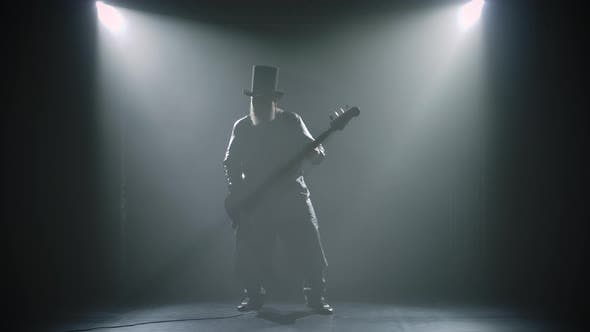 Thumbnail for Bearded Rock Bass Guitarist Plays a Solo Part During a Studio Performance with Smoke and Neon Lights