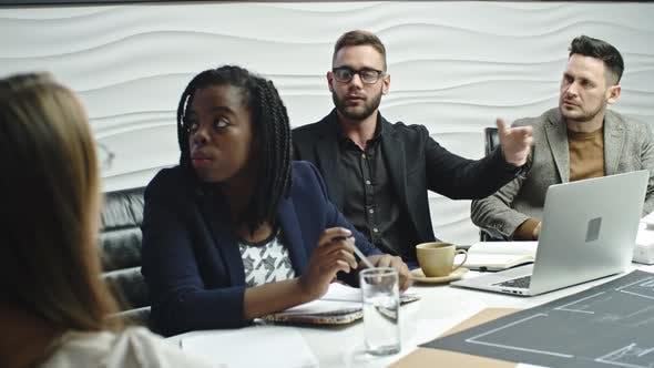 Thumbnail for Interracial Business Team at Seminar