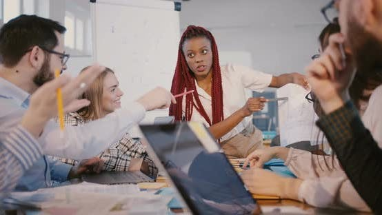 Thumbnail for Experienced African American Development Company Boss Woman Works Together with Multiethnic