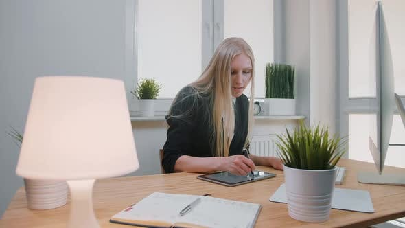 Thumbnail for Business Women Working on Tablet in Office. Attractive Blond Female with Long Hair in Elegant Suit