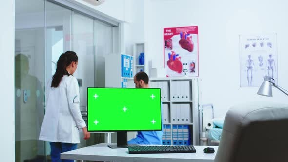 Computer with Green Screen in Hospital Cabinet