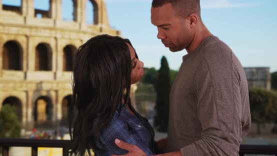 Thumbnail for African-American couple in love have private moment near Colosseum in Rome