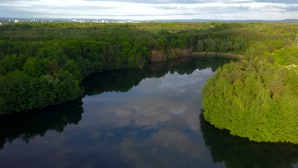 Thumbnail for AERIAL: Lake Surrounded By Green Forest, Summer, Sunshine