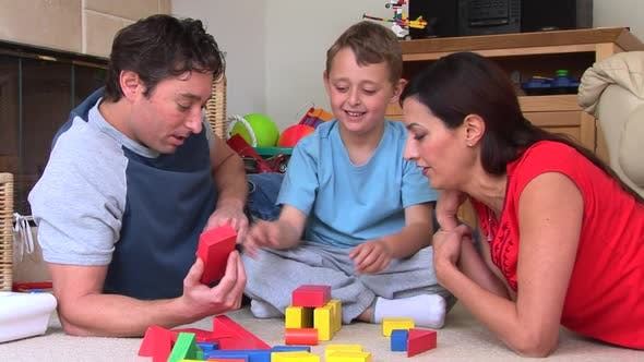 Thumbnail for Parents building blocks with son