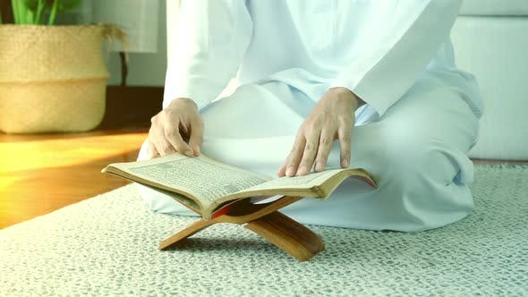 Asian Muslim Man Reading the Qur'an