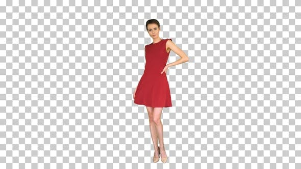 Thumbnail for Girl in a red dress, posing, straightens her dress, Alpha Channel