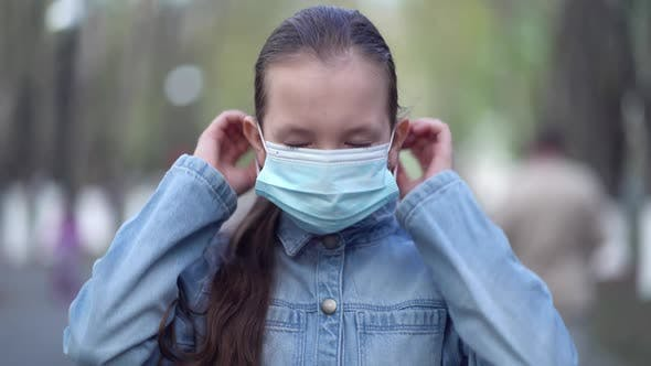 Pandemic Portrait of Girl Wearing Protective Mask in Urban