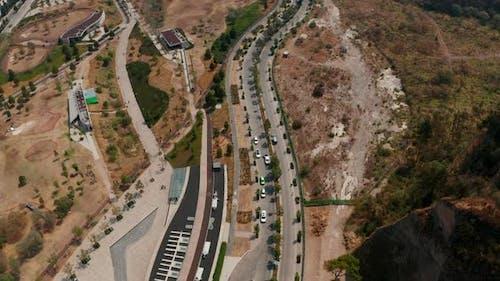 Aerial Drone View of Winding Road Leading Around Public Park La Mexicana in Santa Fe