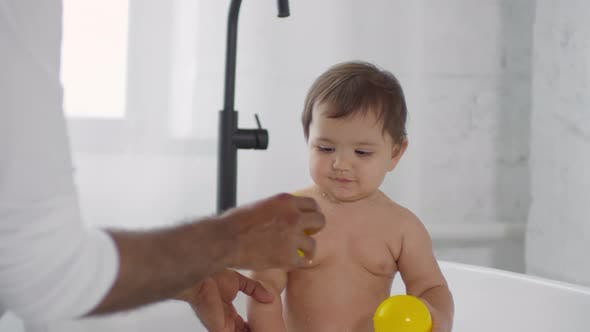 Thumbnail for Father Playing with Cute Toddler Girl Taking Bath