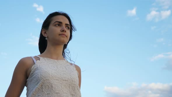 Thumbnail for Dainty Girl Thinking About Her Future at Black Sea Under Blue Sky in Summer in Slo-mo