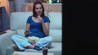 Sitting on Sofa Usig Smartphone