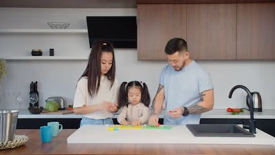 Positive Asian Family Creating with Modeling Clay at Home