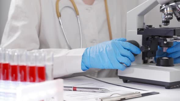 A Scientist in a Modern Laboratory Performs a Blood Test