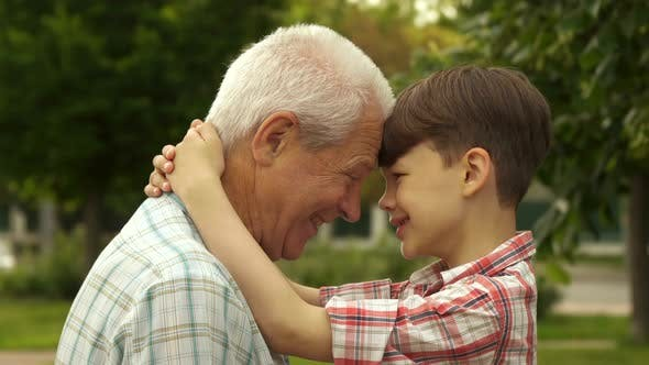 Thumbnail for Senior Man and His Grandson Leaning Their Foreheads One Against Other