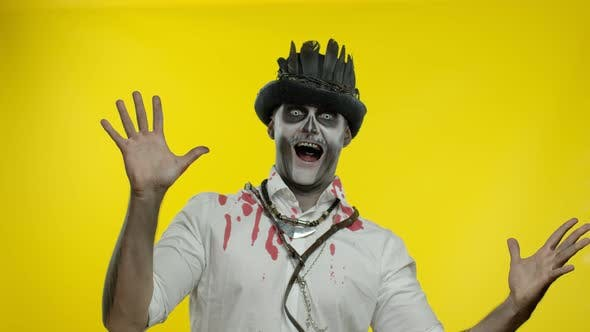 Crazy Man with Horrible Halloween Skeleton Makeup Appears From Bottom Side, Trying To Scare