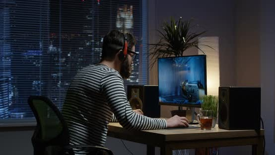 Thumbnail for Young Man Playing Video Game Inside a Room