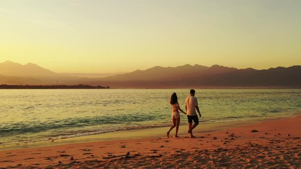 Thumbnail for Young man and woman married on vacation enjoy life on beach on sunny white sandy background 4K