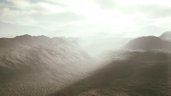 Aerial Vulcanic Desert Landscape with Rays of Light