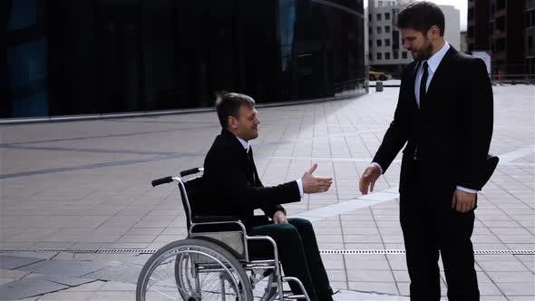 Thumbnail for Happy Entrepreneur Shaking Hands With Disabled Employee