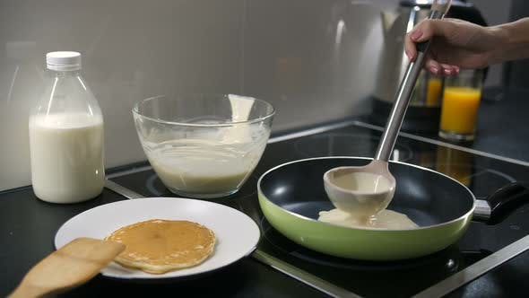 Cover Image for Hand Pouring Pancake Batter Into the Pan