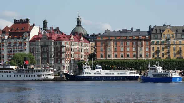 Thumbnail for Classic builings in Östermalm with ferry passing by in Stockholm Sweden