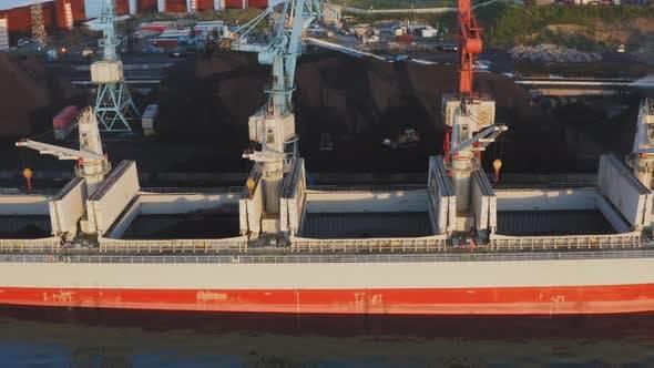 Crane Load a Big Ship with Coal