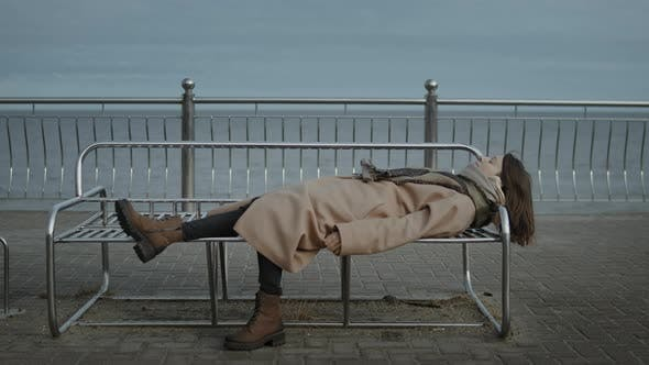 Woman Is Lying On A Bench