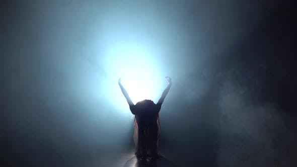 Thumbnail for Slow Motion of Woman Dancing Contemporary in Dark Studio Against Spotlight.