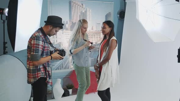 Thumbnail for Photo Shoot Backstage: Make-up Artist Applying Makeup on Attractive Model of African Ethnicity.
